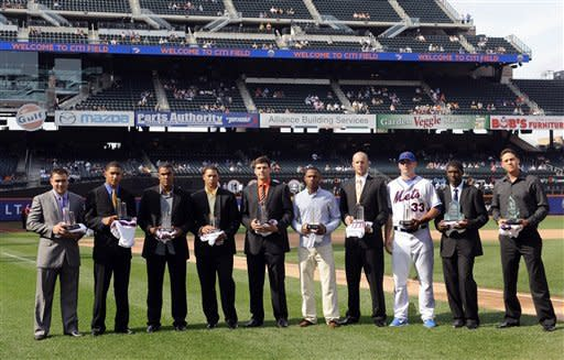 The New York Mets rookie players are honored with the 2012 Sterling Equities Awards before the baseball game against the Atlanta Braves on Saturday, Sept. 8, 2012, at Citi Field in New York. From left are Vincente Lupo, Yoryi Nuez, Miller Diaz, Hansel Orbles, Michael Fulmer, Alonzo Harris, Zack Wheeler, Matt Harvey, Rafael Montero and Wilmer Flores. (AP Photo/Kathy Kmonicek)