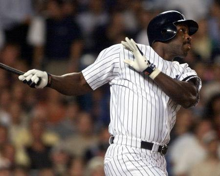 FILE PHOTO - New York Yankees batter Chili Davis swings on a second inning home run off Boston Red Sox pitcher Pedro Martinez September 10 at Yankee Stadium. RFS/RC