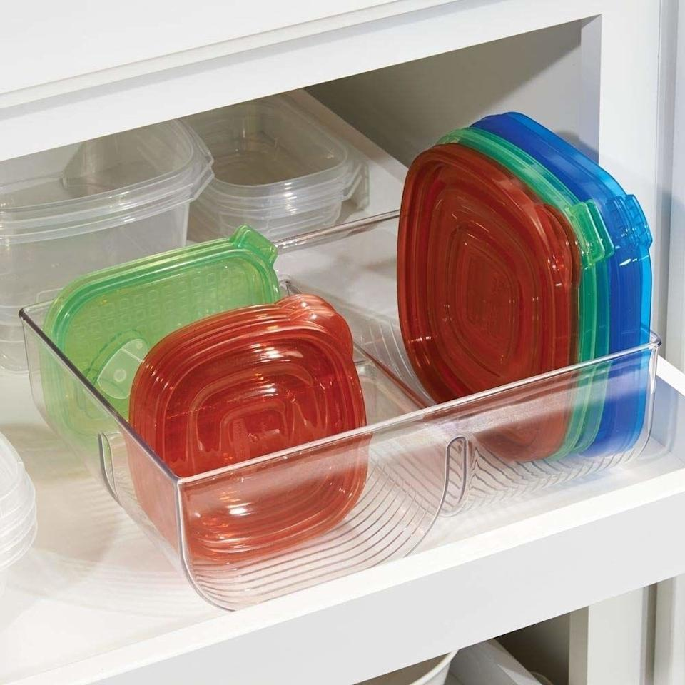 """You can start stacking all of your Tupperware containers together and save some sacred storage space.<br /><br /><strong>Promising review:</strong>""""This does exactly what it says it does. It holds a variety of lid sizes and fits nicely inside the cabinet.<strong>It is so nice to be able to find the exact lid you are looking for without having to rummage around inside the cabinet.</strong>I would recommend this product."""" —<a href=""""https://www.amazon.com/dp/B01CMLG4NG?tag=huffpost-bfsyndication-20&ascsubtag=5833640%2C27%2C43%2Cd%2C0%2C0%2C0%2C962%3A1%3B901%3A2%3B900%3A2%3B974%3A3%3B975%3A2%3B982%3A2%2C16261700%2C0"""" target=""""_blank"""" rel=""""noopener noreferrer"""">shelby2289<br /></a><br /><strong>Get it from Amazon for<a href=""""https://www.amazon.com/dp/B01CMLG4NG?tag=huffpost-bfsyndication-20&ascsubtag=5833640%2C27%2C43%2Cd%2C0%2C0%2C0%2C962%3A1%3B901%3A2%3B900%3A2%3B974%3A3%3B975%3A2%3B982%3A2%2C16261700%2C0"""" target=""""_blank"""" rel=""""noopener noreferrer"""">$13.99</a>(available in two colors).</strong>"""