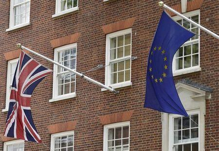 The British Union flag and European Union flag are seen hanging outside Europe House in central London June 9, 2015. REUTERS/Toby Melville