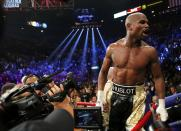Floyd Mayweather, Jr. of the U.S. yells out to the crowd after defeating Manny Pacquiao of the Philippines in their welterweight WBO, WBC and WBA (Super) title fight in Las Vegas, Nevada, May 2, 2015. REUTERS/Steve Marcus