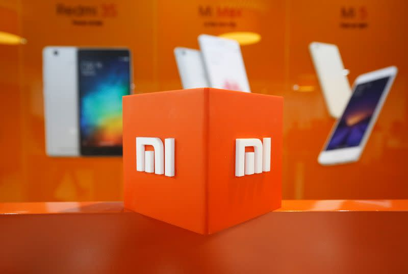 FILE PHOTO: The logo of Xiaomi is seen inside the company's office in Bengaluru