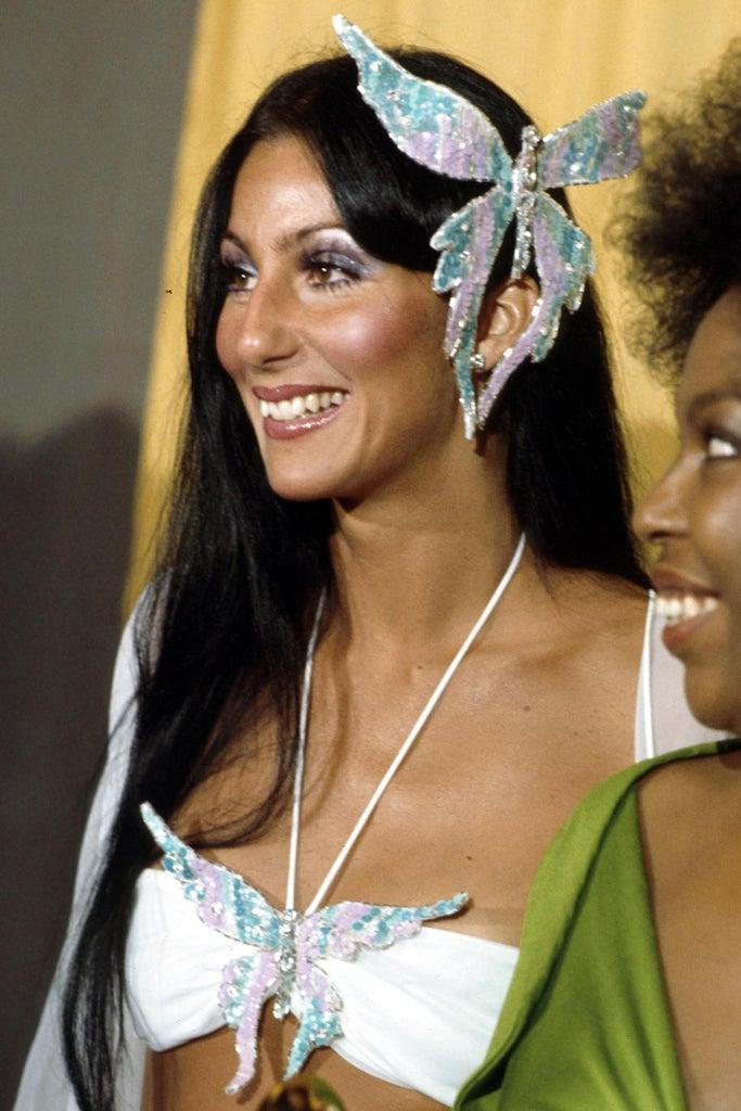 LOS ANGELES – MARCH 2: Entertainer Cher attends the Grammy awards wearing a large butterfly pin in her hair on March 2, 1974 in Los Angeles, California. (Photo by Michael Ochs Archives/Getty Images)