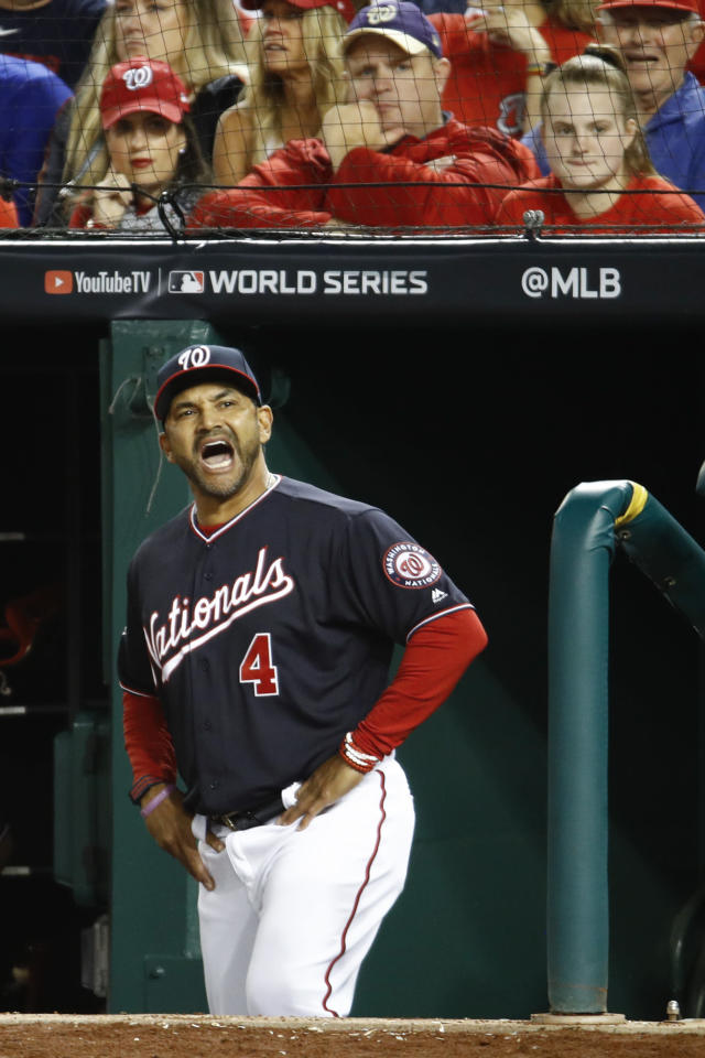 Washington Nationals manager Dave Martinez yells at the home plate umpire during the sixth inning of Game 5 of the baseball World Series against the Houston Astros Sunday, Oct. 27, 2019, in Washington. (AP Photo/Patrick Semansky)