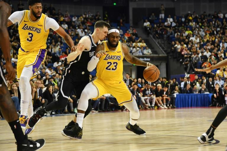Sports stars like LeBron James -- pictured at a pre-season match in Shanghai, China -- will be part of the attraction for platforms about to be launched by WarnerMedia and Disney