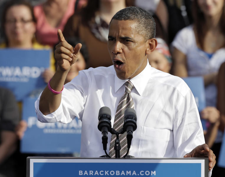 President Obama gestures while speaking at a campaign event at Ybor Centennial Park in Tampa, Fla., Thursday, Oct. 25, 2012. The president is on the second day of his 48 hour, 8 state campaign blitz. (AP Photo/Chris O'Meara)