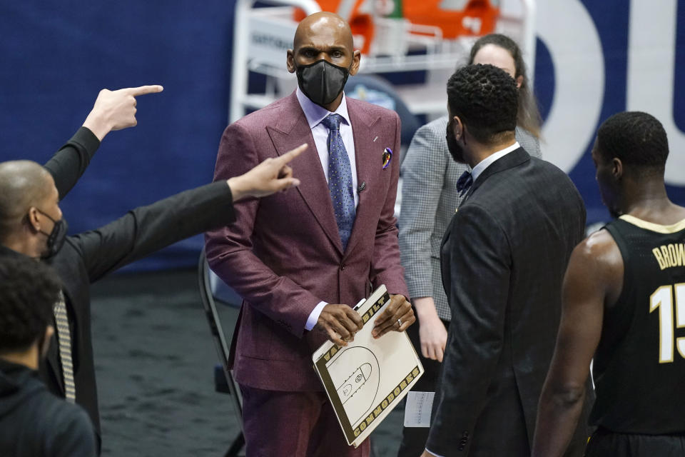 Vanderbilt head coach Jerry Stackhouse prepares to talk to his players during a timeout in the first half of an NCAA college basketball game against Florida in the Southeastern Conference Tournament Thursday, March 11, 2021, in Nashville, Tenn. (AP Photo/Mark Humphrey)