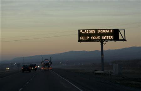 A sign advising motorists of a drought is seen along Interstate 5 near Canuta Creek, California in this February 14, 2014 file photo. REUTERS/Robert Galbraith/Files
