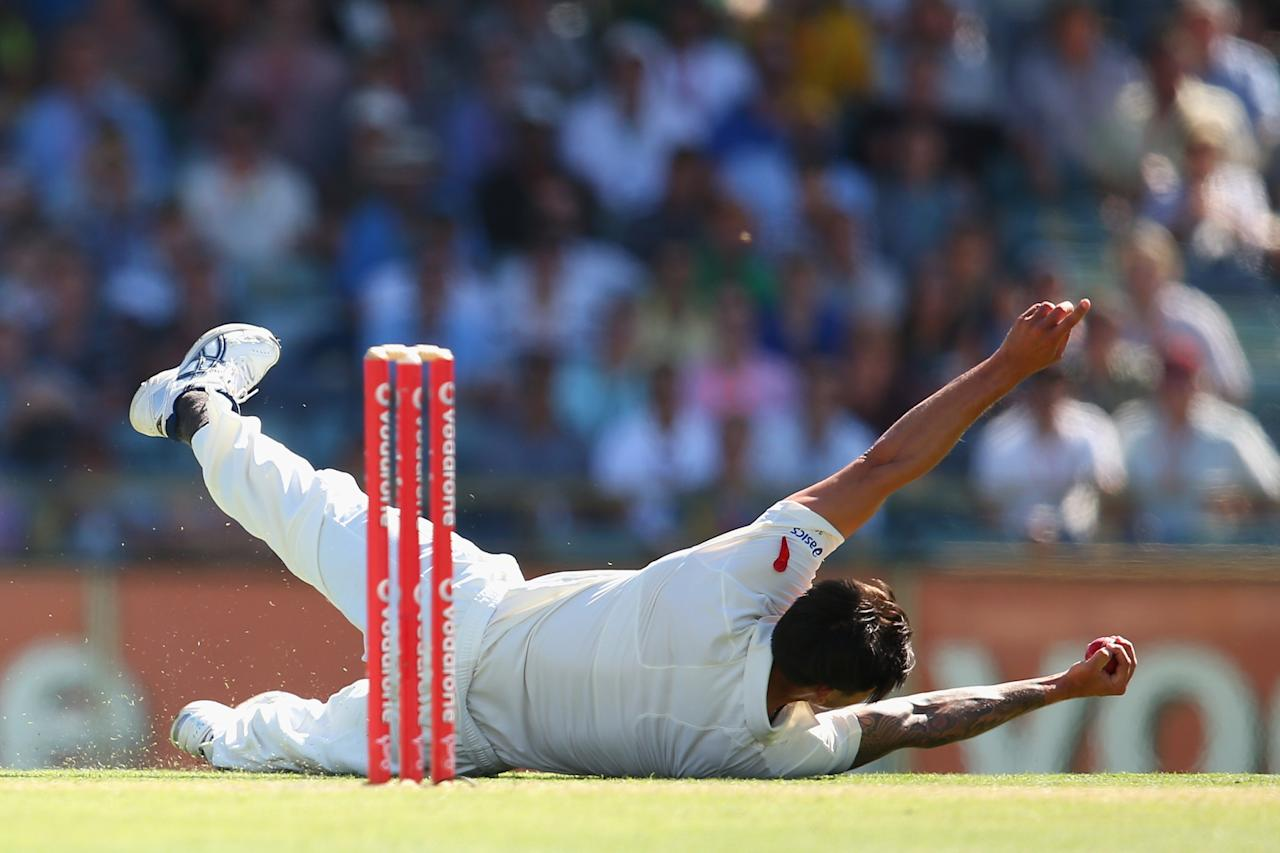 PERTH, AUSTRALIA - DECEMBER 01:  Mitchell Johnson of Australia catches out Alviro Petersen of South Africa off his own delivery during day two of the Third Test Match between Australia and South Africa at the WACA on December 1, 2012 in Perth, Australia.  (Photo by Cameron Spencer/Getty Images)