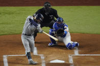 Tampa Bay Rays' Brandon Lowe hits a home run against the Los Angeles Dodgers during the first inning in Game 2 of the baseball World Series Wednesday, Oct. 21, 2020, in Arlington, Texas. (AP Photo/Sue Ogrocki)