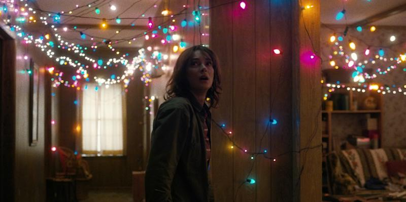 Joyce Byers (played by Winona Ryder) illuminates her living room with Christmas lights to prove that Will is trying to talk to her from the Upside Down. — Picture courtesy of Netflix