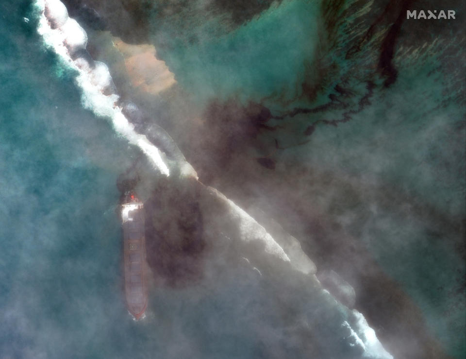 "In this satellite image provided by 2020 Maxar Technologies on Friday, Aug. 7, 2020, an aerial view of oil leaking from the MV Wakashio, a bulk carrier ship that recently ran aground off the southeast coast of Mauritius. The prime minister of Mauritius says the government is appealing to France for help with a brewing environmental disaster after a ship that ran aground almost two weeks ago off the Indian Ocean island nation began leaking oil. Prime Minister Pravind Jugnauth said Friday that the leak ""represents a danger for Mauritius"" and that his country doesn't have the skills and expertise to refloat stranded ships. ( 2020 Maxar Technologies via AP)"
