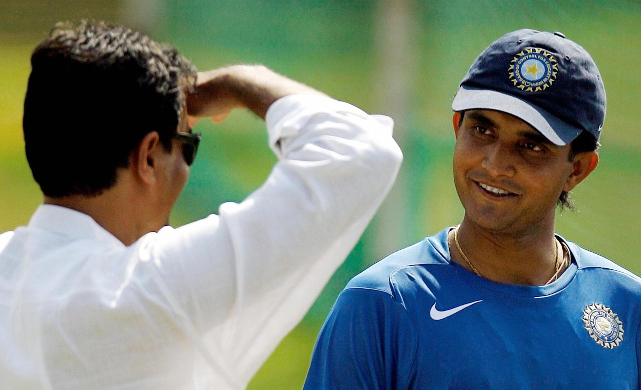 VADODARA, INDIA: Chief Indian selector Dilip Vengsarkar (L) speaks to cricketer Sourav Ganguly during a training session in Vadodara, 30 January 2007. India lead the four match One day International series against West Indies by 2-1, with the final match to be played on 31 January.  AFP PHOTO/ Indranil MUKHERJEE  (Photo credit should read INDRANIL MUKHERJEE/AFP/Getty Images)