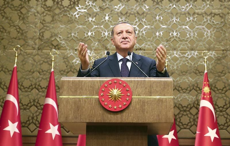 Turkey's President Recep Tayyip Erdogan gestures, during a meeting with local media representatives, in Ankara, Turkey, Wednesday, March 22, 2017. Tensions between Turkey and Europe have boiled in recent weeks, but acrimony over Turkey's belief that some European countries are harboring suspected terrorists has festered for years. Erdogan criticized Germany Wednesday for allowing a weekend rally of Kurds, some of whom expressed support for a jailed rebel leader in Turkey.(Kayhan Ozer/Presidential Press Service, Pool Photo via AP)