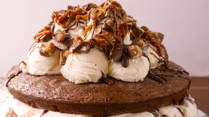"""<p>Calling all Snickers lovers: this brownie ice cream cake will blow your mind!</p><p>Get the recipe from <a href=""""https://www.delish.com/cooking/recipes/a48753/snickers-ice-cream-cake-recipe/"""" rel=""""nofollow noopener"""" target=""""_blank"""" data-ylk=""""slk:Delish"""" class=""""link rapid-noclick-resp"""">Delish</a>.</p>"""