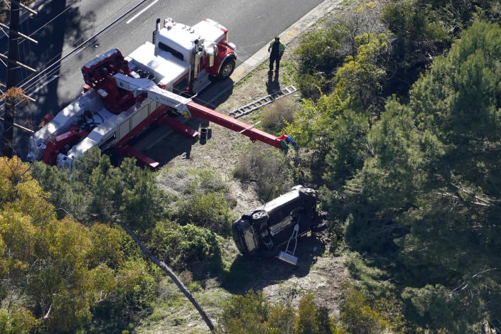 A vehicle rests on its side after a rollover accident involving golfer Tiger Woods Tuesday, Feb. 23, 2021, in Rancho Palos Verdes, Calif., a suburb of Los Angeles. Woods suffered leg injuries in the one-car accident and was undergoing surgery, authorities and his manager said. (AP Photo/Mark J. Terrill)