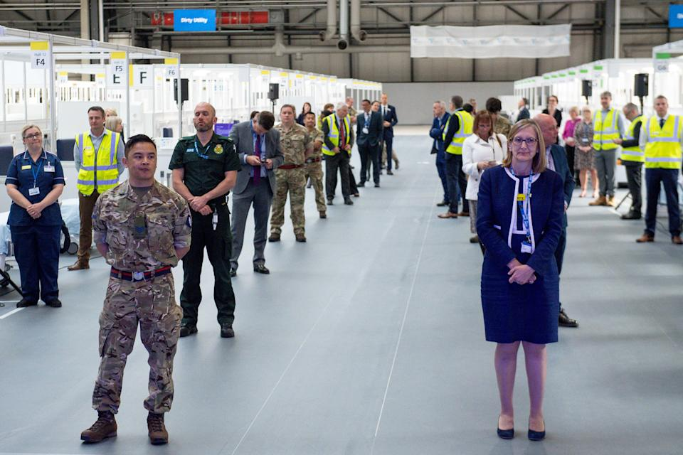 BIRMINGHAM, ENGLAND - APRIL 16: Members of the NHS, Miltary and construction sector attend as Prince William, Duke of Cambridge opens the new NHS Nightingale Hospital via video link on April 16, 2020 in Birmingham, England. The Coronavirus (COVID-19) pandemic has spread to many countries across the world, claiming over 130,000 lives and infecting over 2 million people. (Photo by Jacob King - WPA Pool/Getty Images)