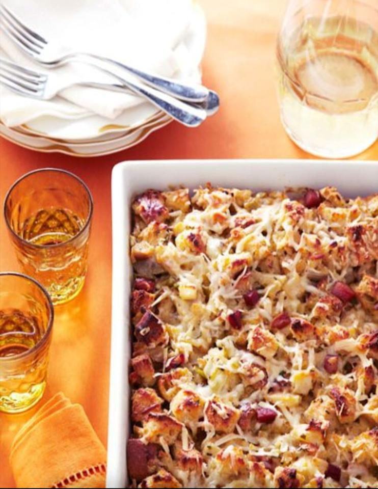 """<p>An interesting and tasty twist on a traditional side dish, this sweet and salty stuffing will have your guests reaching for seconds. </p><p><a href=""""https://www.womansday.com/food-recipes/food-drinks/recipes/a40065/herb-apple-stuffing-bread-pudding-recipe-ghk1111/"""" target=""""_blank""""><em>Get the recipe for Herb and Apple Stuffing Bread Pudding.</em></a> </p>"""