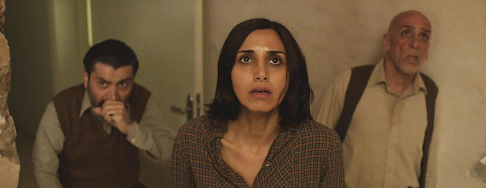 """<p><strong>Under the Shadow</strong> takes place during the Iran-Iraq conflict, and it focuses on a Tehran woman whose husband is at war. While caring for their infant daughter, the woman becomes convinced that evil spirits have possessed their house.</p> <p>Watch <a href=""""http://www.netflix.com/title/80096786"""" class=""""link rapid-noclick-resp"""" rel=""""nofollow noopener"""" target=""""_blank"""" data-ylk=""""slk:Under the Shadow""""><strong>Under the Shadow</strong></a> on Netflix now.</p>"""