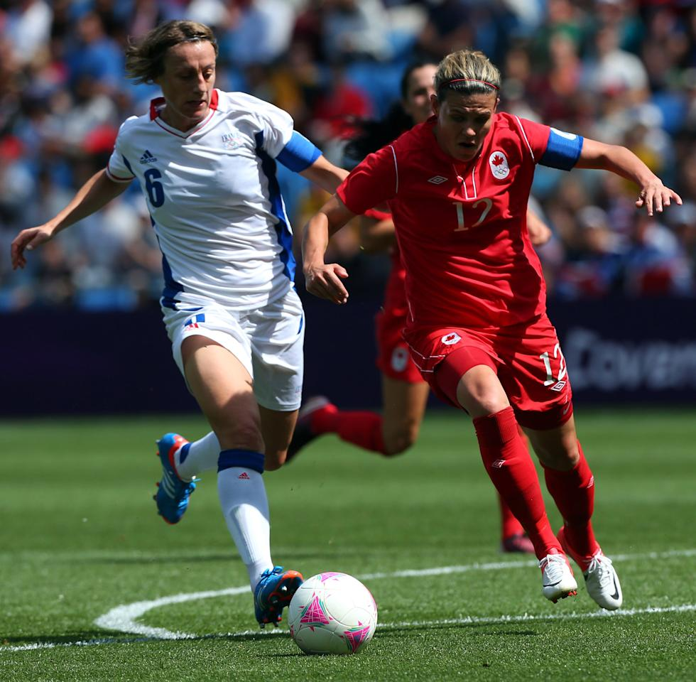 COVENTRY, ENGLAND - AUGUST 09:  Christine Sinclair of Canada pulls away from Sandrine Soubeyrand of France during the Women's Football Bronze Medal match between Canada and France, on Day 13 of the London 2012 Olympic Games at City of Coventry Stadium on August 9, 2012 in Coventry, England.  (Photo by Stanley Chou/Getty Images)