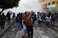 Demonstrators clash with members of the security forces during a protest against what they say was police brutality exerted in recent protests against President Ivan Duque's government's tax reform in Cali