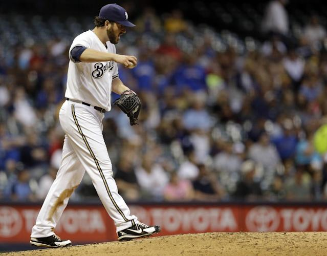 Milwaukee Brewers starting pitcher Donovan Hand reacts after giving up a home run to San Diego Padres' Will Venable during the fourth inning of a baseball game Tuesday, July 23, 2013, in Milwaukee. (AP Photo/Morry Gash)