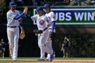 Chicago Cubs third baseman Kris Bryant, left, center fielder Ian Happ, center, and first baseman Anthony Rizzo, right, celebrate at the end of a baseball game against the San Francisco Giants, Thursday, Aug. 22, 2019, in Chicago. (AP Photo/Matt Marton)