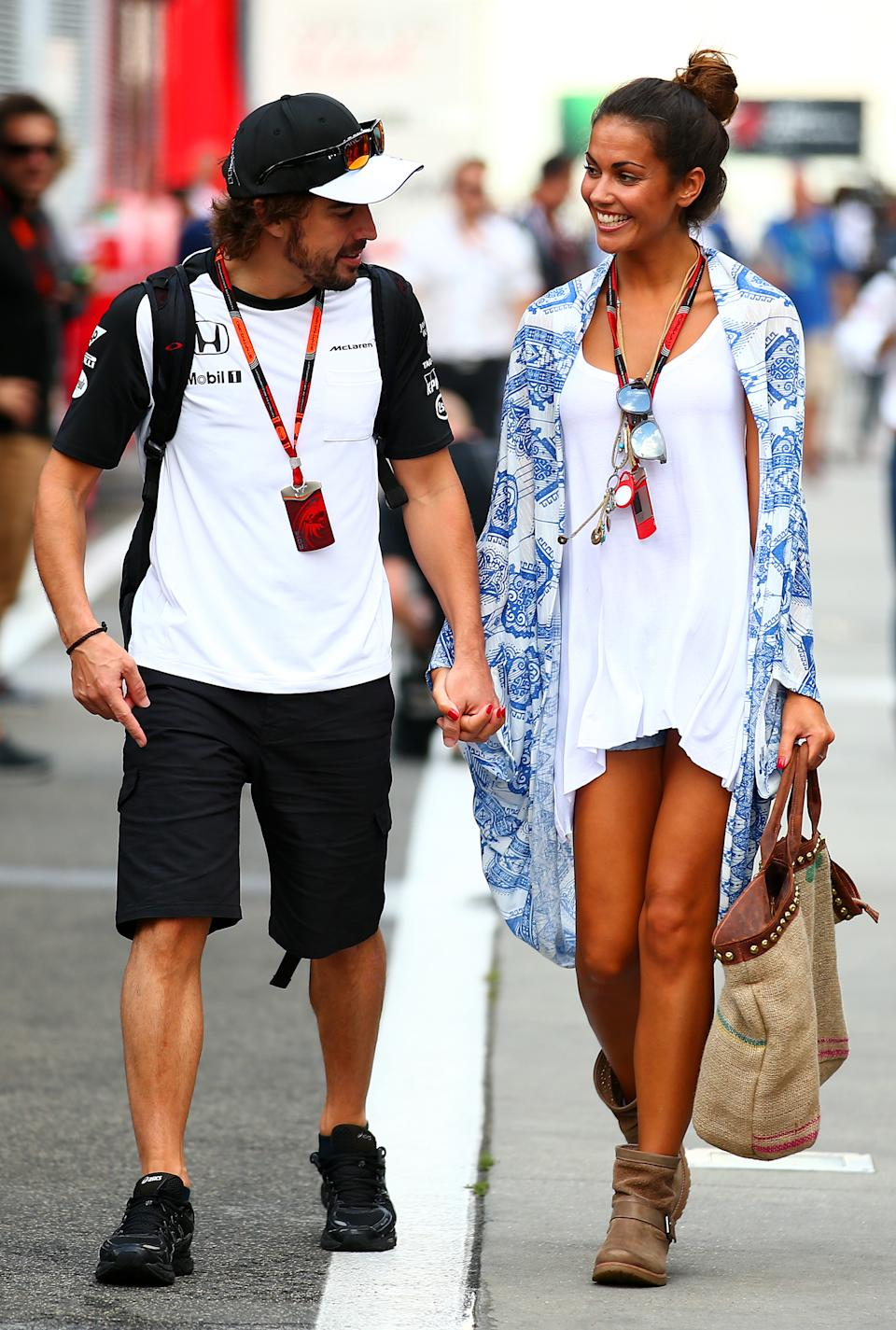 BUDAPEST, HUNGARY - JULY 25:  Fernando Alonso of Spain and McLaren Honda and his girlfriend Lara Alvarez walk in the paddock after qualifying for the Formula One Grand Prix of Hungary at Hungaroring on July 25, 2015 in Budapest, Hungary.  (Photo by Mark Thompson/Getty Images)