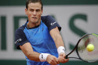 Canada's Vasek Pospisil plays a shot against Italy's Matteo Berrettini in the first round match of the French Open tennis tournament at the Roland Garros stadium in Paris, France, Tuesday, Sept. 29, 2020. (AP Photo/Christophe Ena)