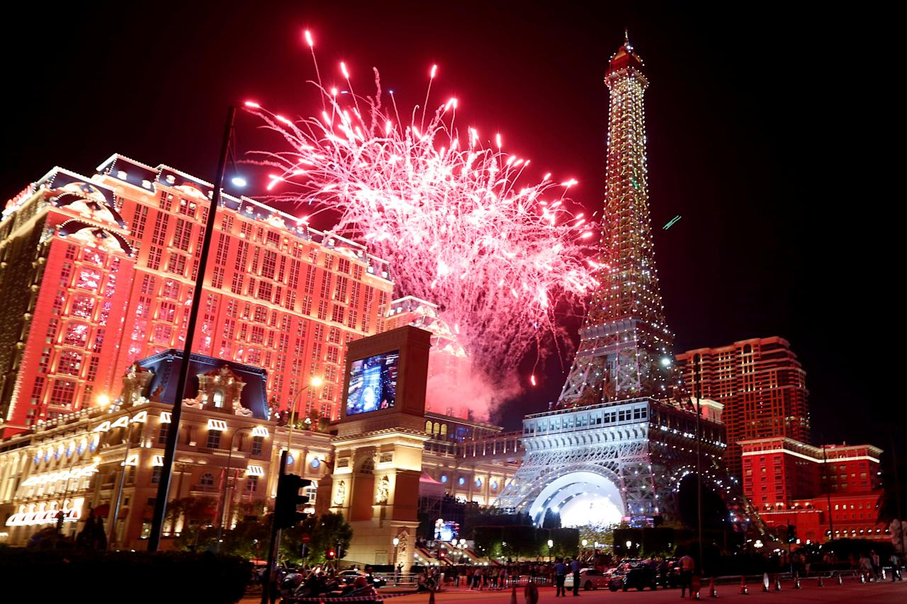 FILE PHOTO - Fireworks explode over Parisian Macao as part of the Las Vegas Sands development during its opening ceremony in Macau, China September 13, 2016.  REUTERS/Bobby Yip/File Photo                           GLOBAL BUSINESS WEEK AHEAD