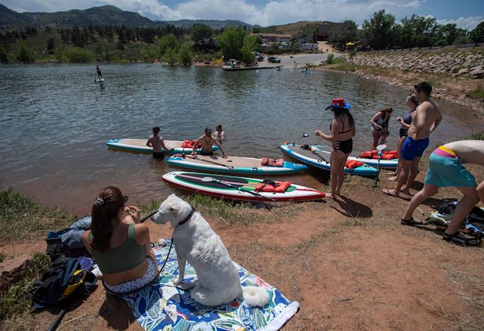People gather near the shore of Horsetooth Reservoir in Fort Collins, Colo., on July 3.