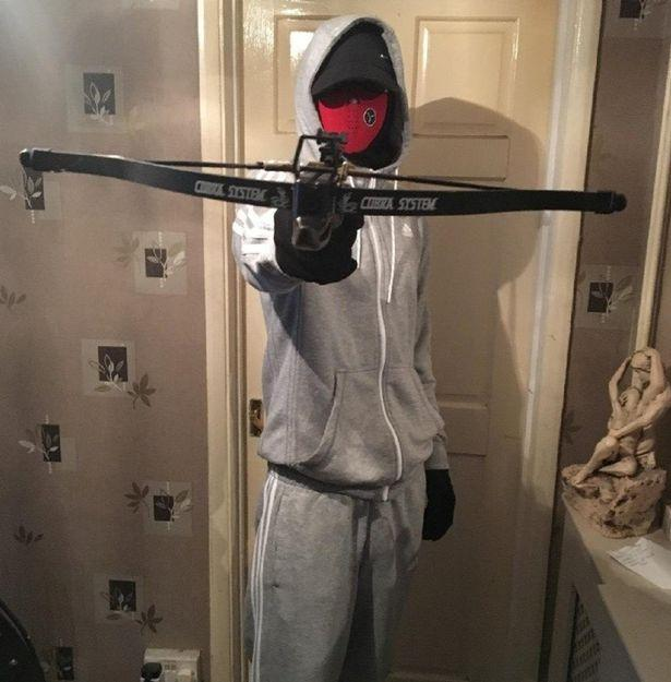 Another picture showed a man holding a crossbow (Picture: SWNS)