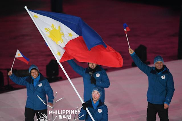 <p>Philippines' flagbearer Asa Miller leads the delegation parade during the opening ceremony of the Pyeongchang 2018 Winter Olympic Games at the Pyeongchang Stadium on February 9, 2018. (Photo by ROBERTO SCHMIDT/AFP/Getty Images) </p>