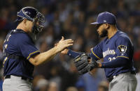 Milwaukee Brewers' Jeremy Jeffress, right and Milwaukee Brewers' Erik Kratz celebrate their team's win over the Chicago Cubs during their baseball game Monday, Sept. 10, 2018, in Chicago. (AP Photo/Jim Young)
