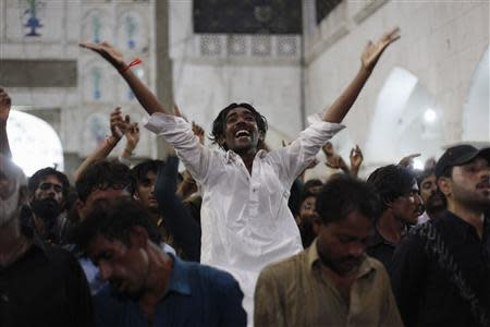 A devotee leaps in trance while dancing with others to the beat of the drum at the tomb of Sufi saint Syed Usman Marwandi, also known as Lal Shahbaz Qalandar, in Sehwan Sharif