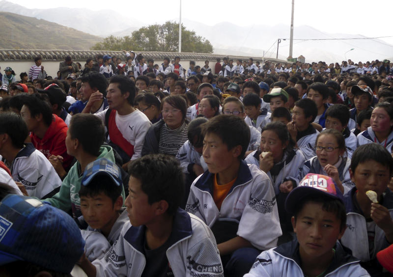 In this Oct. 19, 2010 photo released by Free Tibet Wednesday Oct. 20, 2010, Tibetan students gather in protest on the streets of Tongren in western China's Qinghai province. Tibetan students in western China marched in protest of unconfirmed plans to use the Chinese language exclusively in classes, teachers said Wednesday, an unusually bold challenge to authorities that reflects a deep unease over cultural marginalization. (AP Photo/Free Tibet) ** EDITORIAL USE ONLY **