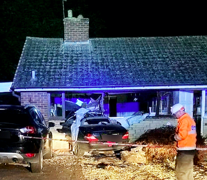 The car was completely embedded in the lounge at the front of the house. (SWNS)