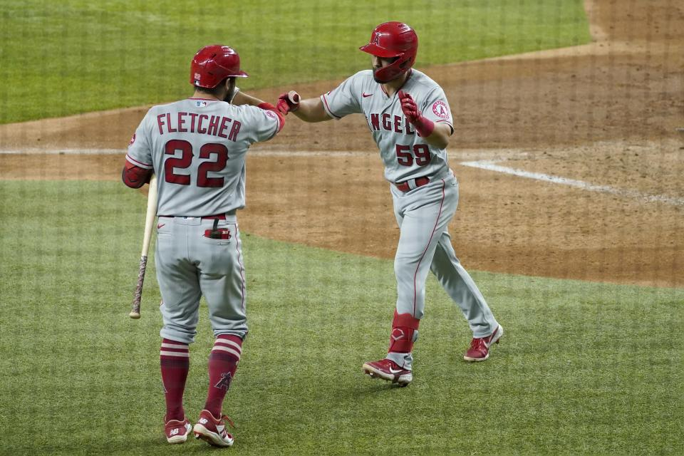 Los Angeles Angels' David Fletcher (22) and Jack Mayfield, right, celebrate a solo home run by Mayfield in the fifth inning of the team's baseball game against the Texas Rangers in Arlington, Texas, Wednesday, Aug. 4, 2021. (AP Photo/Tony Gutierrez)