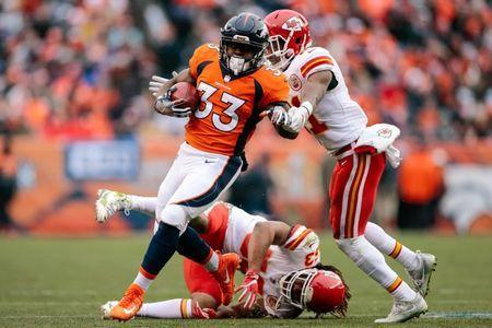 Dec 31, 2017; Denver, CO, USA; Denver Broncos running back De'Angelo Henderson (33) runs through the tackle of Kansas City Chiefs linebacker Ramik Wilson (53) and defensive back Eric Murray (21) for a touchdown in the second quarter at Sports Authority Field at Mile High. Mandatory Credit: Isaiah J. Downing-USA TODAY Sports
