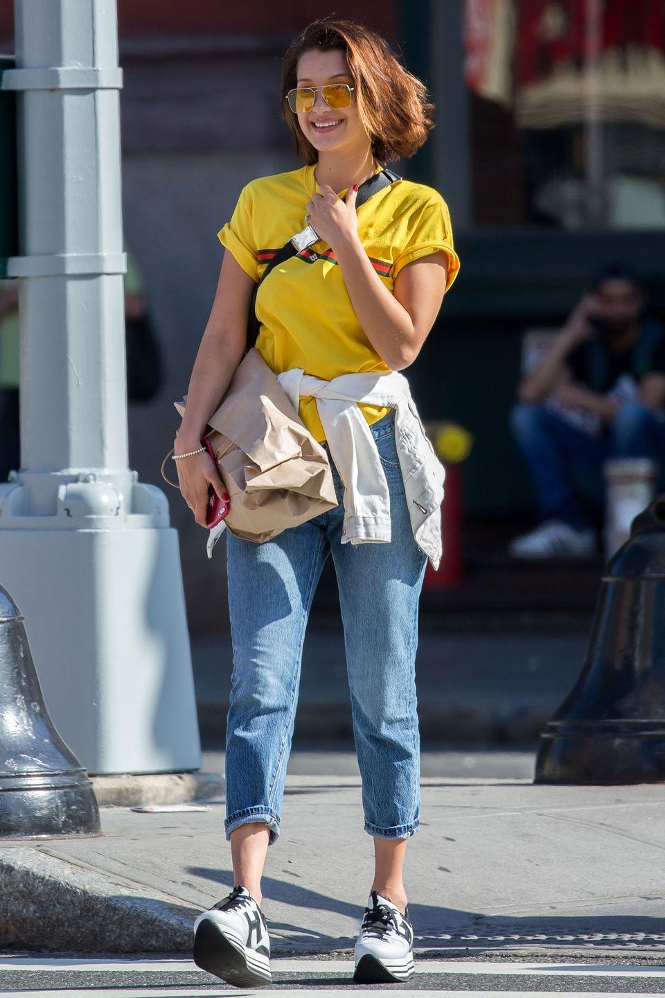 <p>In a yellow shirt, glasses, cropped jeans and Hogan sneakers out in NYC. </p>