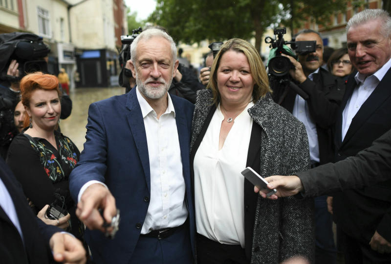 Labour Party leader Jeremy Corbyn , centre left, celebrates with newly elected Labour MP Lisa Forbes at Cathedral Square, following her victory in the Peterborough by-election, in Peterborough, England, Friday June 7, 2019. (Stefan Rousseau/PAvia AP)