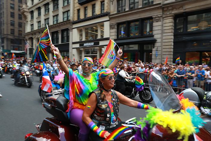 Women riding motorcycles waved rainbow colored flags during the N.Y.C. Pride Parade in New York on June 30, 2019. (Photo: Gordon Donovan/Yahoo News)