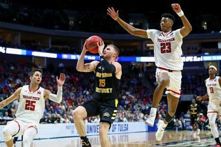 Mar 22, 2019; Tulsa, OK, USA; Northern Kentucky Norse guard Tyler Sharpe (15) shoots while defended by Texas Tech Red Raiders guard Davide Moretti (25) and guard Jarrett Culver (23) during the second half in the first round of the 2019 NCAA Tournament at BOK Center. Mandatory Credit: Mark J. Rebilas-USA TODAY Sports