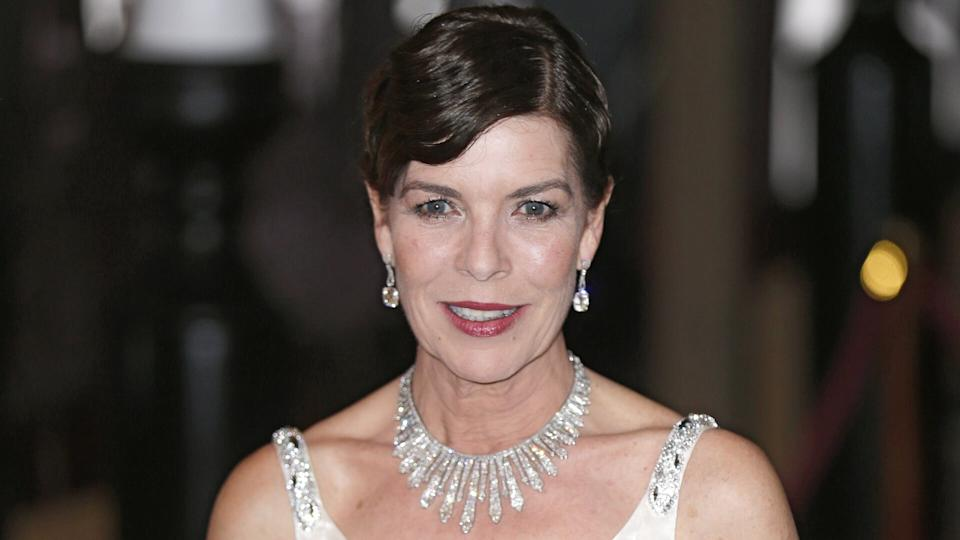 Mandatory Credit: Photo by Lionel Cironneau/AP/REX/Shutterstock (6732110n)Princess Caroline of Hanover poses for photographers as she arrives at the Rose Ball in Monaco, .