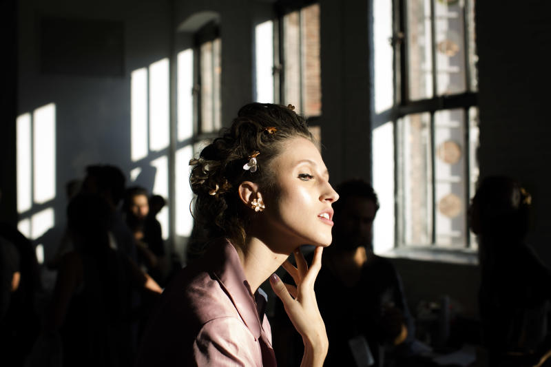 Anna Cleveland, of the Netherlands, poses for a photograph backstage before the Zac Posen Spring 2014 collection is modeled during Fashion Week in New York, Sunday, Sept. 8, 2013. (AP Photo/John Minchillo)