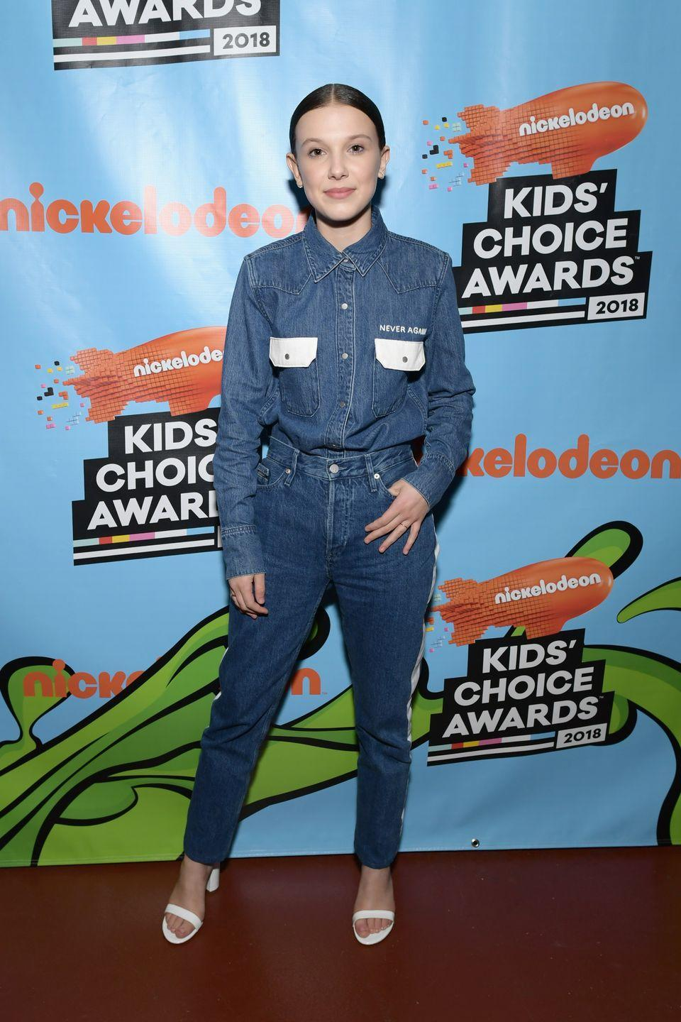 <p>Photo evidence that the secret to pulling off a denim-only outfit is all in the way you wear it. Button your shirt all the way up, then tuck it in to make it look like a chic suit that just happens to be made out of jeans.</p>