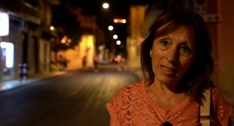 Giovanna Licitra in Sicily with fire in the background.