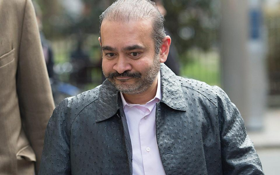 Mr Modi wearing a £10,000 ostrich hide jacket when confronted in the street by a Telegraph reporter in 2019 - Eddie Mulholland