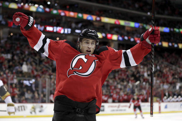 New Jersey Devils left wing Miles Wood reacts after scoring a goal against the Vegas Golden Knights during the second period of an NHL hockey game, Friday, Dec. 14, 2018, in Newark. (AP Photo/Julio Cortez)
