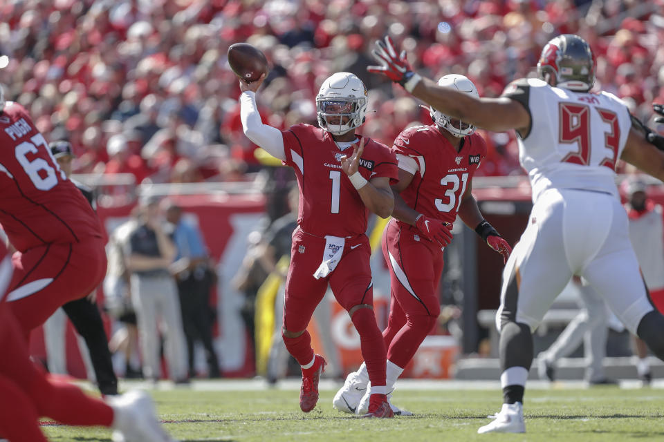 TAMPA, FL - NOVEMBER 10: Quarterback Kyler Murray #1 of the Arizona Cardinals attempt to pass over Defensive Tackle Ndamukong Suh #93 of the Tampa Bay Buccaneers during the game at Raymond James Stadium on November 10, 2019 in Tampa, Florida. The Buccaneers defeated The Cardinals 30 to 27. (Photo by Don Juan Moore/Getty Images)
